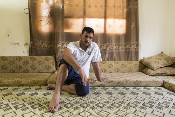 Mafraq district. Urban refugees. A Syrian father in his rented home.